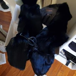 Black coach fur vest